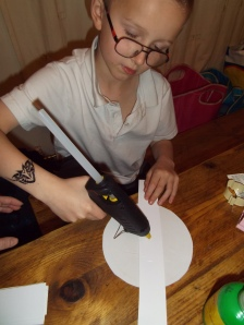 child using glue gun
