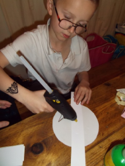 child using glue gun